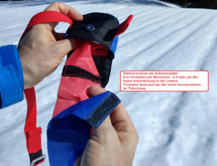 Sollreisstelle zwischen find---me LAwinenband (rot) und Tiefschneeband (blau). Verhindert Verletzungen im Tiefschnee und Ankerwirkung in der Lawine.